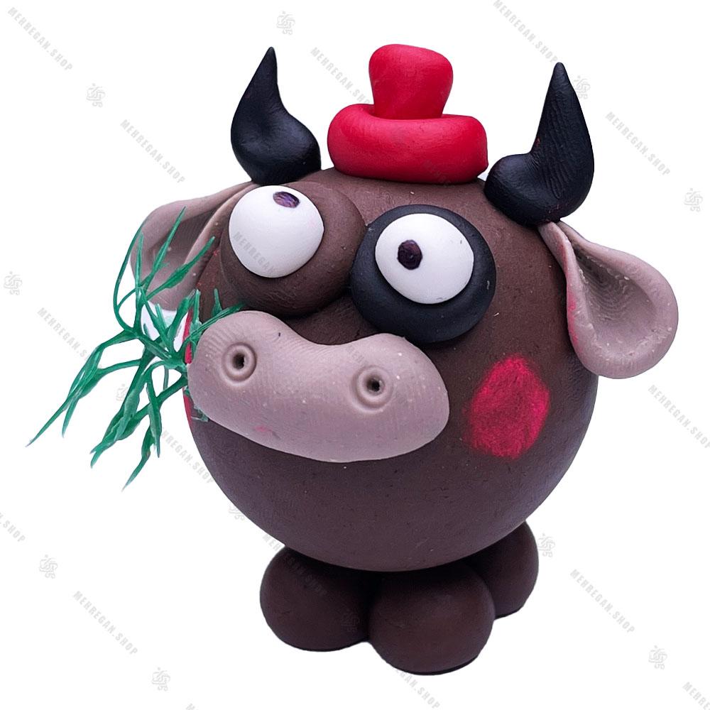 مجسمه خمیری گاو قهوهای